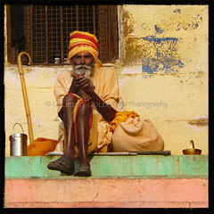 The Support Of This World (designldg) Tags: portrait people orange india man male heritage smile mystery square photography freedom asia colours peace expression faith culture atmosphere human soul elder devotion tradition spiritual shanti hindu dharma hinduism kashi dignity oldcity timeless ganga ganges quietness ghats benares benaras garment  vanarasi indiasong sdhu panasonicdmcfz18 uttarpradseh