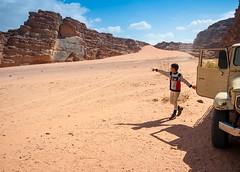 ... (Gabriel M.A.) Tags: boy mountains lumix sand child desert jeep dune wadirum jordan pointing f71 jordanie 14mm gf1 4x3 1442 panasoniclumixgvario1442mmf35f56asph