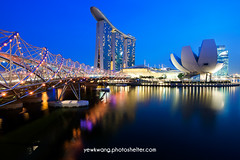 Marina Bay Sand 01 (yewkwangphoto) Tags: sea seascape water horizontal museum architecture skyscraper reflections shopping landscape singapore cityscape bluesky tourist nightscenery placeofinterest commercialbuildings buildingstructure photocategory marinabaysand yewkwang artsciencemuseum thehelixbridge photographybyyewkwang