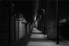 lonely path (Save your breathe, take a picture!) Tags: wall concrete nightshot columns overpass nighttime barbed deserted