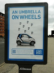 Car2Go - An Umbrella on Wheels (ell brown) Tags: greatbritain england mobile birmingham unitedkingdom samsung billboard mobileshots smartcar westmidlands daimler qrcode jcdecaux europcar jameswattqueensway car2go steelhouseconservationarea flickrandroidapp:filter=none samsunggalaxyace2 car2gosmartcar anumbrellaonwheels