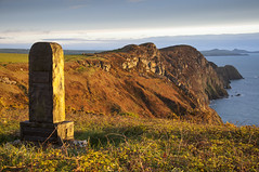 Warm evening light at Pwll Deri (Keartona) Tags: uk light sea stone wales landscape evening coast memorial cliffs british pembrokeshire deri pwll