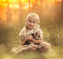 In Your Arms... (liliaalvarado) Tags: children blond kitten cat girl child childhood warm emotions nature golden light photography canon 135mm
