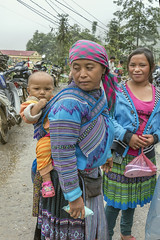 Looking back at baby (tmeallen) Tags: cocly marketday bluehmong ethnicminority traditionalattire babyonback motorcycles rainyday smilingwoman threepeople sapa borderregions laocai northvietnam culture travel