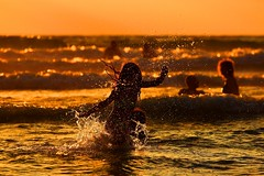 Playing in the sea at sunset - Tel-Aviv beach (Lior. L) Tags: playingintheseaatsunsettelavivbeach playing sea sunset telaviv beach goldenhour goldenlight action silhouettes waves telavivbeach israel