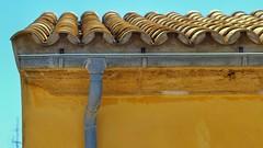 Alcudia (old town) (David Ward4) Tags: alcudia alcudiaoldtown canon canon550d yellow roof tiles drain sky spain majorca