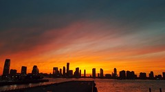 Looking West across the Hudson River to Jersey City at sunset (conaero) Tags: nyc sunset hudson river nj skyline buildings water