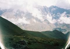 (Nikolay Kulivets) Tags: 35mm film olympusmjuii mjuii kodak georgia monastery kazbek caucasus alpinism rocks clouds