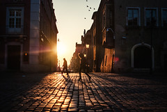 Did you miss me? (ewitsoe) Tags: winter ewitsoe nikond80 morning dawn sunrise woman walking oldmarket city cityscape poznan poland staryrynek buildings architecture sun cold brisk