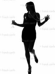 stylish silhouette   woman partying drinking  cocktail (Franck Camhi) Tags: shadow party people woman white cute sexy girl beautiful beauty silhouette female standing cutout fun happy person one glasses 1 amusement necklace glamour holding dress champagne joy fulllength drinking style happiness pearls indoors cocktail whitebackground drinks alcohol friendly casual studioshot grayscale sensuality beverages enjoying enjoyment pleasure oneperson stylish caucasian champagneflute onewoman