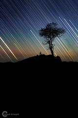 The movement of stars (Ateyah J. Hujaili) Tags: silhouette night canon stars photography high movement exposure jay photographer saudi arabia t3i بدر badr yanbu 600d عطية المصور ينبع الحجيلي canon600d ateyah ateyahjay