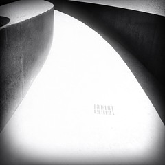 Walk This Way (Sharon LuVisi) Tags: cameraphone california blackandwhite bw abstract monochrome concrete mono vanishingpoint losangeles walk curves highcontrast jazz monotone sidewalk walkway walls 365 iphone melodie leadinglines thegettycenter 2013 mobilephotography 42513 iphone365 drainageholes aobw hipstamatic 3652013 snapseed