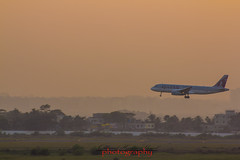 Landing (Shajal1) Tags: life pink blue sunset red sky sun white black color nature beautiful beauty yellow closeup plane canon wonderful dark lens landscape photography eos golden evening fly flying amazing nice colorful dof village shot 300mm 55mm disk dell excellent hassan dhaka lovely bangladesh 75mm supershot 70mm300mm canon60d shajal blinkagain gettyimagesbangladeshq12012 qamrul qamrulhassanshajal