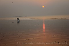 A NEW DAWN (Munisch) Tags: morning travel light red sea india color reflection water sunrise canon geotagged photography eos rebel photo focus asia 1855mm digha stillphotography 550d t2i