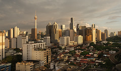 KL before sundown (Andrew Tan 2011) Tags: city sunset urban tower skyline buildings landscape evening warm skyscrapers sundown dusk malaysia kualalumpur kl stacked oldandnew flickrchallengegroup flickrchallengewinner