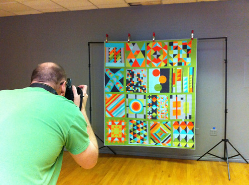Bill photographing the PMQG Graphic quilt for the Quilt Index!