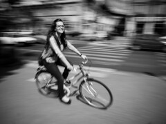in a fraction of a second (Dvid Papp) Tags: bw motion blur girl bicycle lumix budapest panasonic cycle g3 14mm
