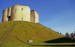 cliffords tower (Ron Layters) Tags: york morning england sun castle grass geotagged early pentax unitedkingdom hill bank slide medieval norman velvia transparency keep cliffordstower fujichrome pentaxmz10 yorkcastle may20 ronlayters slidefilmthenscanned mz10 2013quot firstbuilt1068 climbingofthebanksprohibitedusesteps geo:lat=5395550831503079 geo:lon=1080205858537358 quothighestpositioninexplore367onmonday