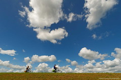 Simplified version of Holland (Johan Konz) Tags: cyclists people blue sky white clouds outdoor zeedijk waterland netherlands cloud landscape dike