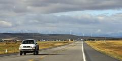 On the road again - Crowsnest Highway, west of Fort MacLeod, Southern Alberta (edk7) Tags: nikond300 nikonnikkor18200mm13556gedifafsvrdx edk7 2008 canada alberta municipaldistrictofwillowcreek crowsnesthighway westoffortmacleod prairie foothills farm field sky cloud ranch crop grass utilitypole pickuptruck pavement windmill windturbine hill toyota