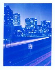 Exit (Markus Jork) Tags: interstate exit lighttrail downtown night blue instant film polaroidblue traffic sign graflex supergraphic