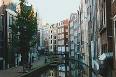 Early Light (Lucas Marcomini) Tags: travel streetphotography architecture lucasmarcomini wanderlust netherlands amsterdam canal river reflection morning light colors dutch traveling trip wander street alley backpacking europe european old town outthere ontheroad urban city life exploration explore exploring