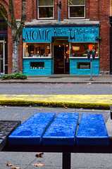 The Atomic Kitten (James_D_Images) Tags: street store blue building vintage bench yellow curb door windows bellingham washingtonstate downtown brick heritage autumn rain