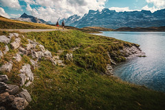 hiking season (Chrisnaton) Tags: hiking hikingseason tannensee switzerland lake mountainlake mountainview outdoor nature mountains bluesky lakeshore swissmountains backpack together walkingtogether alongthelake journey