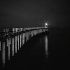 guiding light (Jon Downs) Tags: uk longexposure light sea bw lighthouse white house black art night digital canon downs creativity photography eos grey pier photo jon flickr artist photographer image united gray creative picture kingdom pic photograph le whitby 7d jondowns