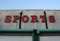 Sports (Flint Foto Factory) Tags: city windows urban chicago brick sign retail evening early store illinois spring 60s afternoon dusk letters sunday north broadway screen front uptown timezone signage april wilson late 1960s rolldown citysports 2013