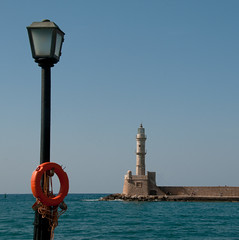 perpendicularity (montel7) Tags: red lighthouse faro harbour lamppost porto rosso lampione canea