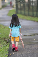 Walking after rain (GI) (Alphone Tea) Tags: life light shadow portrait favorite orange playing motion black blur cute green wet water girl beautiful smile rain childhood closeup kids composition contrast umbrella pose print children fun happy photography evening daylight photo amazing model singapore asia pretty alone bright little sweet bokeh modeling outdoor walk great models chinese young longhair adorable run age after lovely 70200 naturalight 2013 60d 70200f28lisiiusm