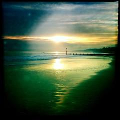 Waterside (Mattstamatic (Matt Brown esq)) Tags: sunset sea cloud sun reflection water digital square groyne bournemouth iphone hipstamatic mattbrownesq