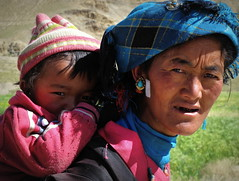 Tibetan mother (PeterCH51) Tags: china portrait woman face kid colours child faces traditional mother culture tibet colourful tradition motherandchild cultural carrying headgear 5photosaday tibetanmother peterch51 flickrtravelaward