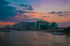 Siriraj hospital twilight (tonbluesman) Tags: city sunset urban building water hospital river landscape thailand twilight cityscape dusk bangkok landmark chaopraya siriraj