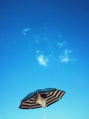 Let's do that summer thing (ale2000) Tags: vsco acg umbrella sunshade sky blue cloud clouds fluffy sea seaside vacations relax stripes striped bleu minimal negative space white low angle view