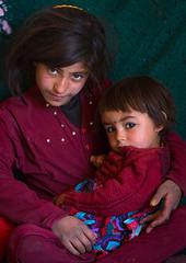 Portraot of an afghan girl with her sister, Badakhshan province, Zebak, Afghanistan (Eric Lafforgue) Tags: afghan533 afghanistan badakhshanprovince centralasia children colourimage community dari girlsonly indoors islam ismaili lifestyles lookingatcamera pamir photography portrait poverty tenderness twopeople vertical waistup wakhan zebak afeganisto
