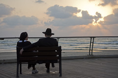A couple at sunset (Dan_lazar) Tags: bein hazmanim tel aviv israel orthodox religious       sunset couple port sea beach