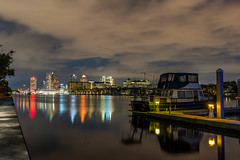 Sitting at the Dock of the Bay (blue5011b) Tags: tampa florida bay water reflection night longexposure dock clouds city skyline nikon d700 2470mm