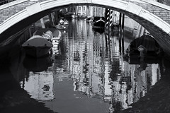 The broken Mirror (andre adams) Tags: reflections water reflection travel bw bridge black white boats arch mirror canal frame ripples distorsion bampw caustics italy venice venezia