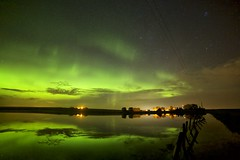 Standing by a fence (John Andersen (JPAndersen images)) Tags: abandoned alberta aurora calgary carstairs clouds farm fence night pond reflections stars