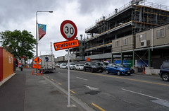 Fed Up With Signs (Jocey K) Tags: newzealand christchurch architecture building cranes rebuild road street cars clouds sky trees justiceandemergencyservicesprecinctbuild signs words flags