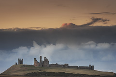 Dunstanburgh Castle (Alistair Bennett) Tags: sunset seascape castle evening coast northumberland howick craster dunstanburgh gnd045se nikkorafs70200mm28gedvrii