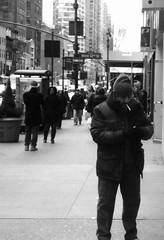 cigarette break on west 32nd (Robert S. Photography) Tags: street nyc winter people bw nikon break manhattan citylife smoking midtown west32nd
