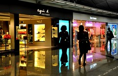 Shopping in Hong Kong (Explore) (missgeok) Tags: lighting light people hk colors composition reflections shopping walking hongkong lightandshadows airport mood colours creative shapes silhouettes atmosphere explore shops colourful shoppers backlighting peopleshopping shinyfloors nikond90 2ladiesand1man