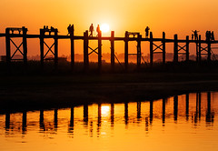 485w (Nadia Isakova) Tags: trip morning travel bridge sunset vacation people orange lake reflection tourism water horizontal reflections landscape asian mirror evening wooden spring still holidays nadia asia southeastasia crossing symbol footbridge dusk many burma traditional famous sightseeing lakes bridges calm destination leisure myanmar tradition longest burmese woodenbridge mandalay crossings teak amarapura ubeinbridge traveldestinations taungthamanlake nadiaisakova