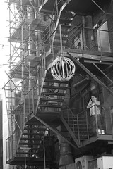 Day 113; On the phone (Shepspics) Tags: decorations bw manchester mono blackwhite chinatown stairway phonecall fireescape scaffold chimneys ladders onthephone day113 airconditioning stairways units mobilephoneuser onthemobile hazysunshine day113365 3652013 week17theme 365the2013edition 23apr13