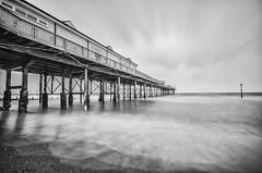 Grand Pier, Teignmouth (danieljsharp) Tags: ocean longexposure sea sky blackandwhite beach nature water photoshop photography mono coast pier photo sand nikon waves sigma devon grandpier teignmouth sigma1020 nd110 d7000 silverefexpro