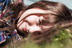 Laying in the grass (Kilkennycat) Tags: portrait girl smile grass canon children happy spring child 50mm14 greeneyes laying 500d kilkennycat t1i ryanconners