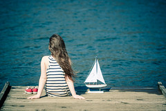 longing to be at sea (Kilkennycat) Tags: blue sea portrait water girl sailboat canon children toy boat dock model child wind stripes sails converse sailor nautical naval 500d kilkennycat t1i ryanconners 100mm28l